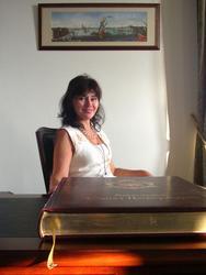 За столом  М.Б. Пиотровского
