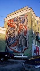 Панно, посвященное космосу на фасаде дома Комсомольского проспекта